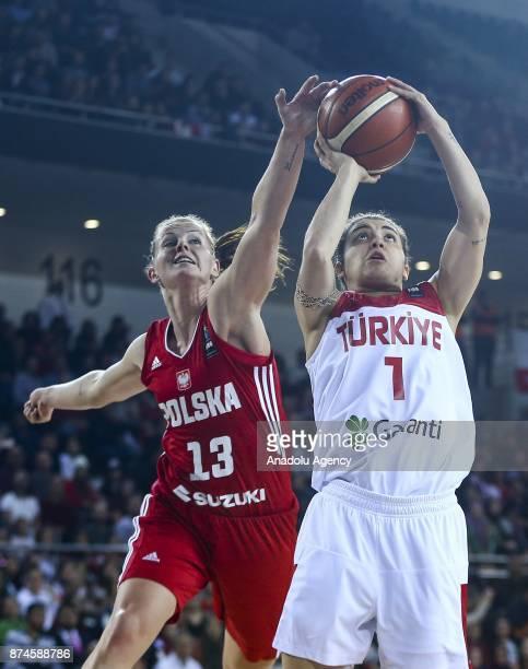 Derya Bilgic of Turkey in action against Maria Gajda of Poland during the 2019 Women FIBA EuroBasket Qualification Group B match between Turkey and...