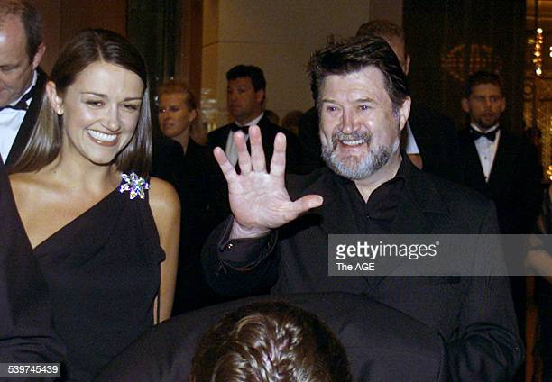 EDDIE MCGUIRE Deryin Hinch queues next to Carla McGuire for his seat allocation at the Microsurgery fundraiser held at Crown Casino 27 February 2002...