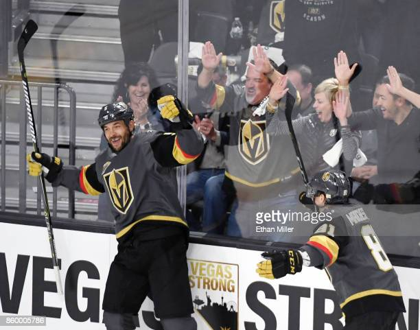 Deryk Engelland of the Vegas Golden Knights celebrates with teammate Jonathan Marchessault after Engelland scored a firstperiod goal against the...