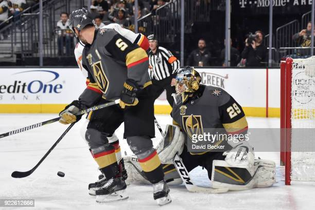 Deryk Engelland and MarcAndre Fleury of the Vegas Golden Knights defend their goal against Mark Jankowski of the Calgary Flames during the game at...