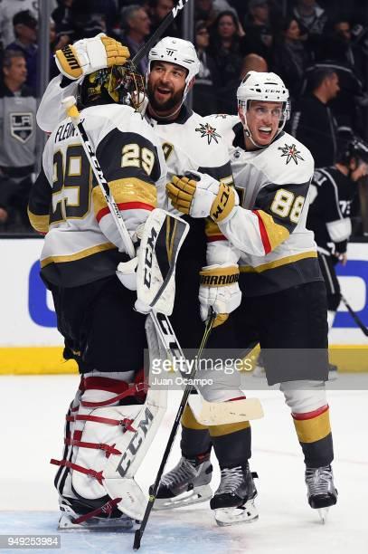 Deryk Engelland and Nate Schmidt of the Vegas Golden Knights congratulate MarcAndre Fleury of the Vegas Golden Knights after a 10 shutout win over...