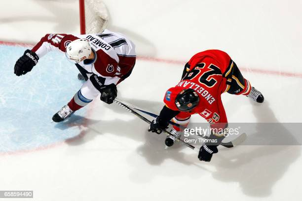Deryk Engelland of the Calgary Flames skates against Blake Comeau of the Colorado Avalanche during an NHL game on March 27 2017 at the Scotiabank...