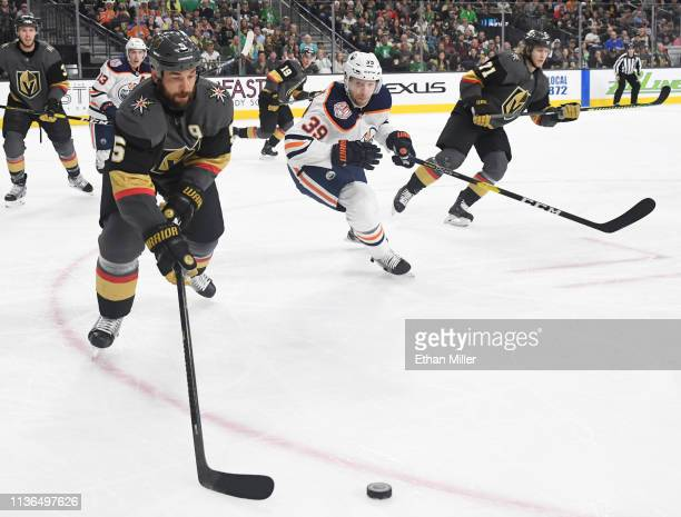 Deryk Engelland of the Vegas Golden Knights and Alex Chiasson of the Edmonton Oilers chase the puck in the first period of their game at TMobile...