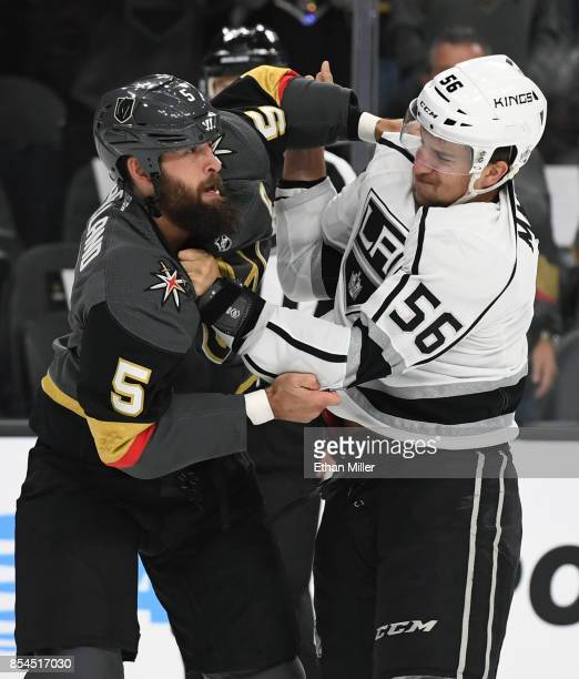 Deryk Engelland of the Vegas Golden Knights and Kurtis MacDermid of the Los Angeles Kings fight in the first period of their preseason game at...