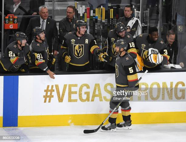 Deryk Engelland of the Vegas Golden Knights celebrates a secondperiod goal by Oscar Lindberg against the Arizona Coyotes at the bench with Cody Eakin...