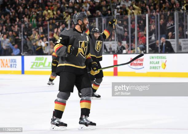 Deryk Engelland of the Vegas Golden Knights celebrates after scoring a goal during the third period against the Calgary Flames at T-Mobile Arena on...