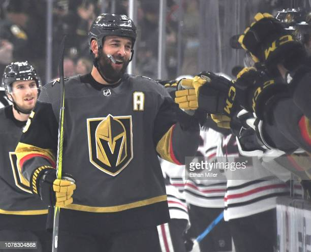 Deryk Engelland of the Vegas Golden Knights celebrates with teammates on the bench after scoring a first-period goal against the Chicago Blackhawks...