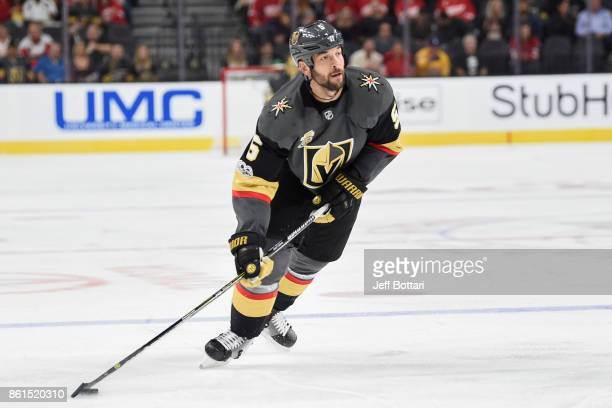 Deryk Engelland of the Vegas Golden Knights handles the puck against the Detroit Red Wings during the game at TMobile Arena on October 13 2017 in Las...