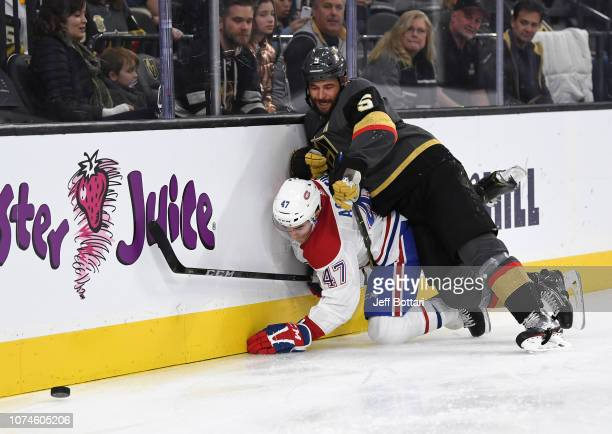 Deryk Engelland of the Vegas Golden Knights hits Kenny Agostino of the Montreal Canadiens during the second period of their game at TMobile Arena on...