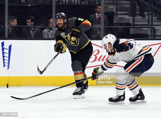 Deryk Engelland of the Vegas Golden Knights passes for an assist against Andrej Sekera of the Edmonton Oilers in the second period of their game at...