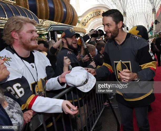 Deryk Engelland of the Vegas Golden Knights signs autographs for fans as he walks a red carpet at the Vegas Golden Knights Fan Fest at the Fremont...