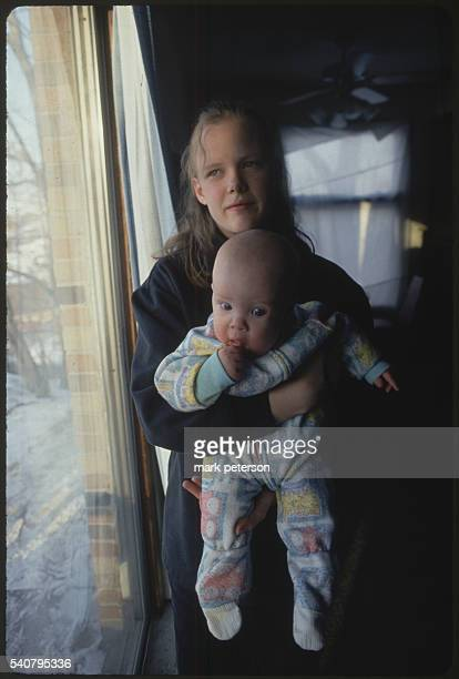 Des Moines, Iowa: Christine Norris , and Baby Dillon, while they visit married friends Audrey and James Bowman with Dillon's father, Brian Mount.