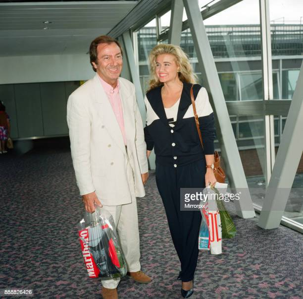 Des O'Connor and girlfriend Jodie Brooke Wilson and Heathrow Airport 30th August 1992