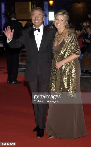 Des O'Connor and wife Jodie arrive for the annual National Television Awards at the Royal Albert Hall in central London *23/03/04 The showbiz veteran...