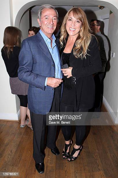 Des O'Connor and wife Jodie Brooke Wilson attends a party celebrating the addition of veteran entertainer Des O'Connor to the cast of the West End...