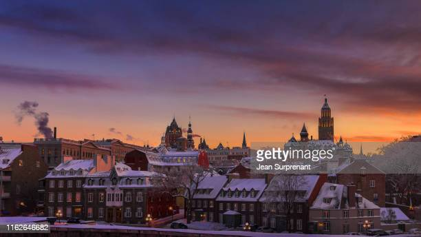 des remparts street winter sunset 16x9 dri - old quebec stock pictures, royalty-free photos & images