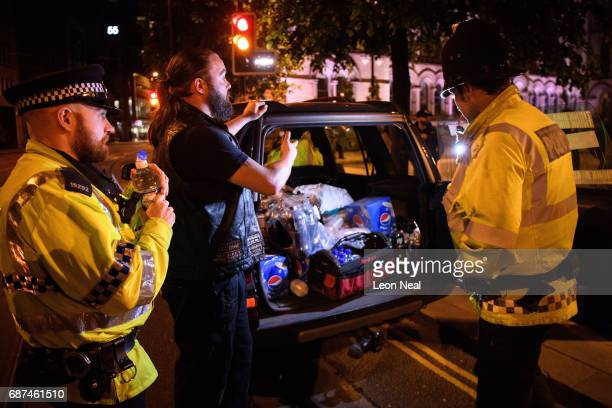 Des Richardson owner of Canine Motorcycle Recovery hands out free food and drink to police and public following an evening vigil outside the Town...