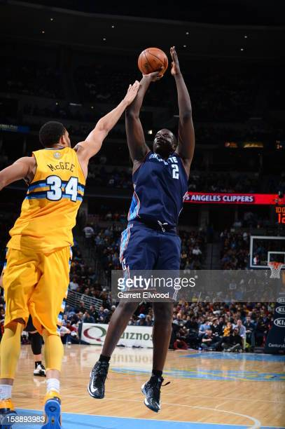 DeSagana Diop of the Charlotte Bobcats shoots against JaVale McGee of the Denver Nuggets on December 22 2012 at the Pepsi Center in Denver Colorado...