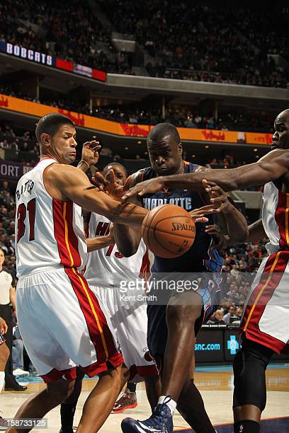 DeSagana Diop of the Charlotte Bobcats shoots against Shane Battier of the Miami Heat at the Time Warner Cable Arena on December 26 2012 in Charlotte...