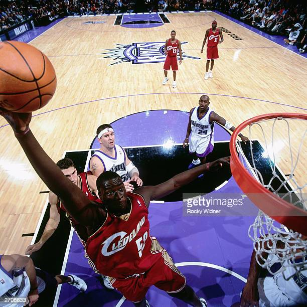DeSagana Diop of the Cleveland Cavaliers goes for a dunk against the Sacramento Kings during the NBA game at the Arco Arena on October 29 2003 in...