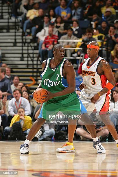 DeSagana Diop of the Dallas Mavericks moves the ball against Al Harrington of the Golden State Warriors during the game at Oracle Arena on April 17,...