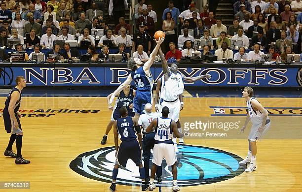 DeSagana Diop of the Dallas Mavericks takes the tip off against Pau Gasol of the Memphis Grizzlies in game one of the Western Conference...