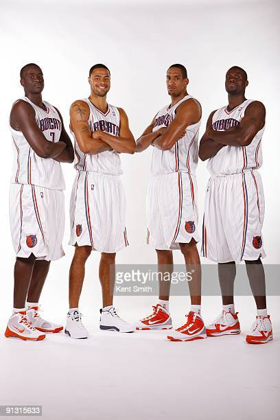 DeSagana Diop Tyson Chandler Alexis Ajinca and Nazr Mohammed of the Charlotte Bobcats pose for a group portrait during 2009 NBA Media Day at Time...