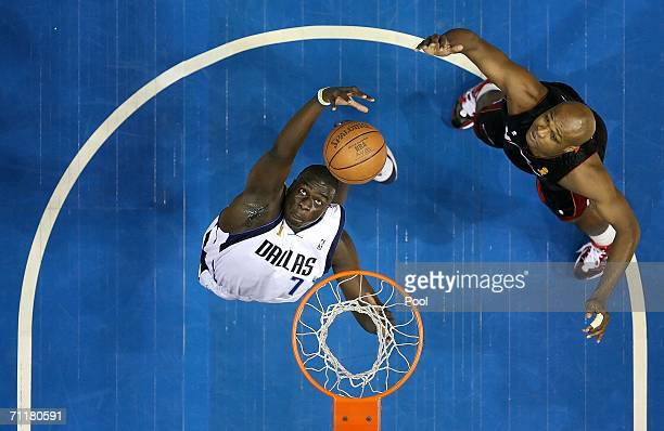 DeSagani Diop of the Dallas Mavericks puts a shot up over Antoine Walker of the Miami Heat in game two of the 2006 NBA Finals on June 11 2006 at...
