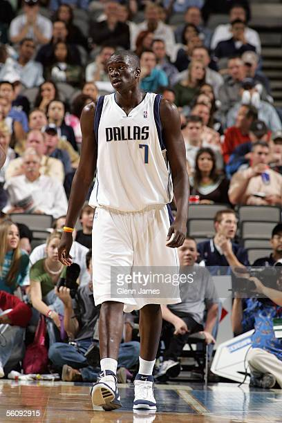 DeSagna Diop of the Dallas Mavericks walks upcourt during the preseason game against the Detroit Pistons at American Airlines Arena on October 27...