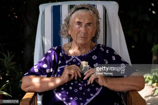 Desamparats Bayona 88 holds a portrait of her father Vicente Bayona as she poses for a portrait at her house on August 29 2018 in Cullera Spain...