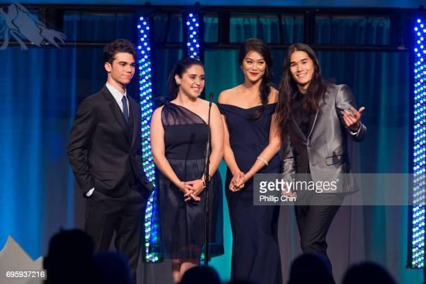 'Descedants 2' cast ameron Boyce Brenna D'Amico Dianne Doan and Booboo Stewart present Executive Producer Ken Ortega the Award of Excellence at the...