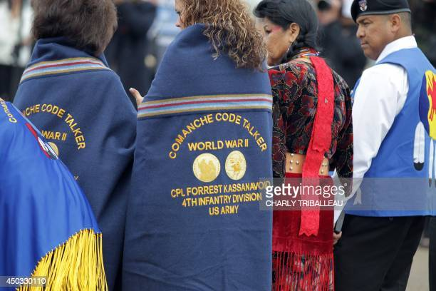 Descendants of Comanche indian soldiers are pictured at Utah Beach museum on June 9 2014 in SainteMarieduMont northwestern France 14 Comanche code...