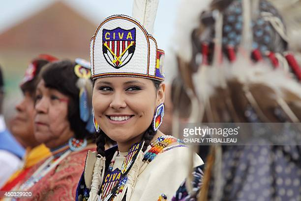 Descendants of Comanche indian soldiers are pictured on June 9 2014 in SainteMarieduMont northwestern France 14 Comanche code talkers landed on June...