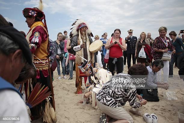 Descendants of Comanche indian soldiers pray on Utah Beach on June 9 2014 in SainteMarieduMont northwestern France 14 Comanche code talkers landed on...
