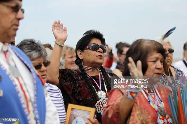 Descendants of Comanche indians soldiers pray on Utah Beach on June 9 2014 in SainteMarieduMont northwestern France 14 Comanche code talkers landed...