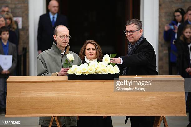 Descendents of King Richard III Michael Ibsen Wendy Duldig and Jeff Ibsen place white roses on the coffin containing the remains of the King outside...