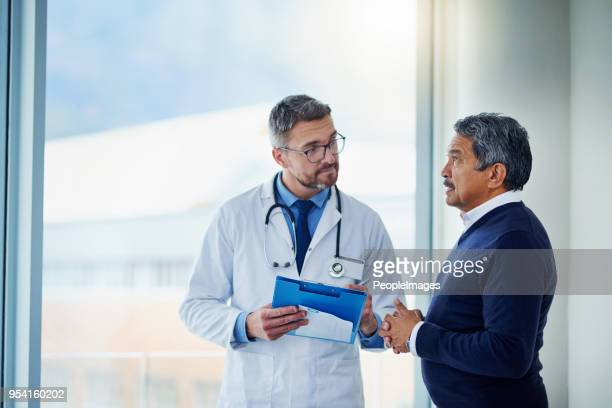 describing all his symptoms down to the detail - male doctor stock photos and pictures
