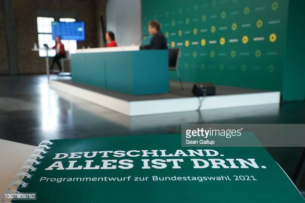 Description of the policy program of the German Greens Party lies on a table as party co-leaders Robert Habeck and Annalene Baerbock speak at a...