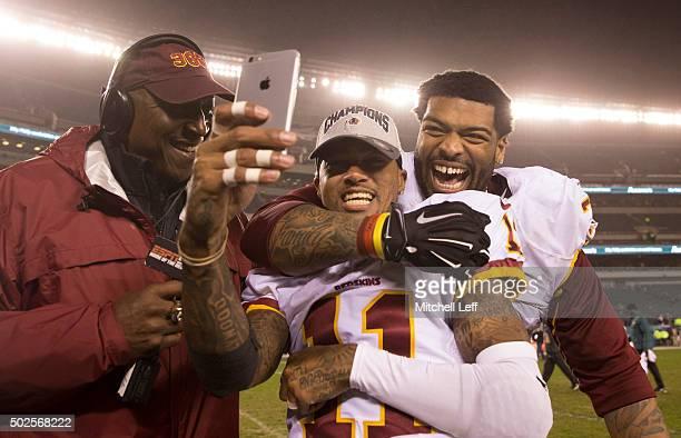 DeSean Jackson and Trent Williams of the Washington Redskins celebrate winning the NFC East division against the Philadelphia Eagles on December 26...