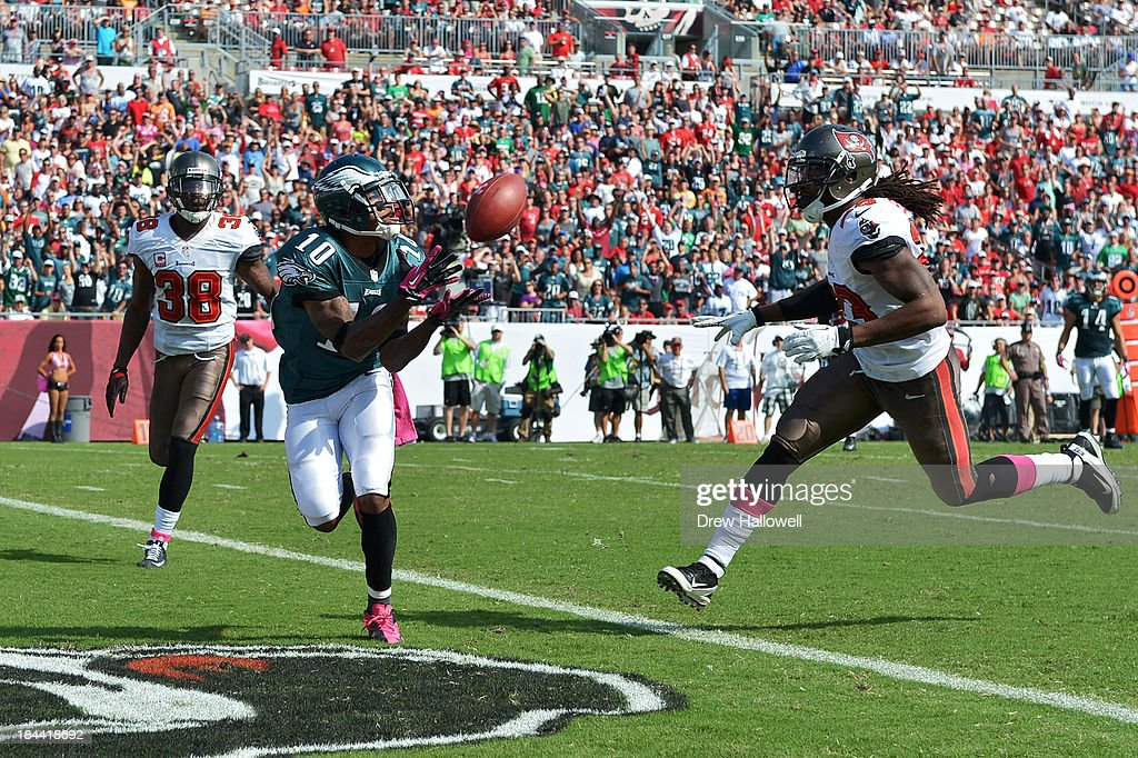 DeSean Jackson #10 of the Philadelphia Eagles catches a pass for a touchdown between Dashon Goldson #38 and Mark Barron #23 of the Tampa Bay Buccaneers at Raymond James Stadium on October 13, 2013 in Tampa, Florida. The Eagles won 30-21.