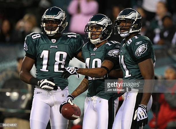 DeSean Jackson of the Philadelphia Eagles celebrates with teammates Jeremy Maclin and Jason Avant after scoring a touchdown in the first quarter...