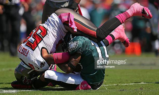 DeSean Jackson of the Philadelphia Eagles is tackled by Mason Foster of the Tampa Bay Buccaneers during a game at Raymond James Stadium on October...