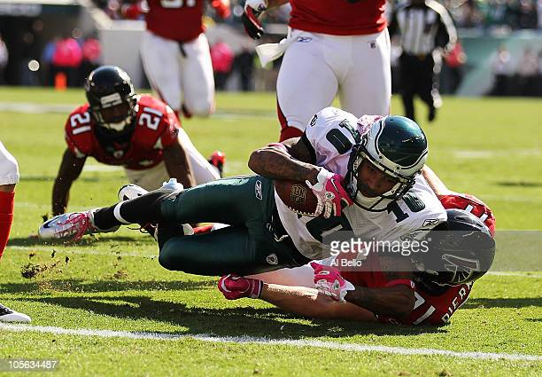 DeSean Jackson of the Philadelphia Eagles scores a touchdown in the first quarter as Kroy Biermann of the Atlanta Falcons defends during their game...