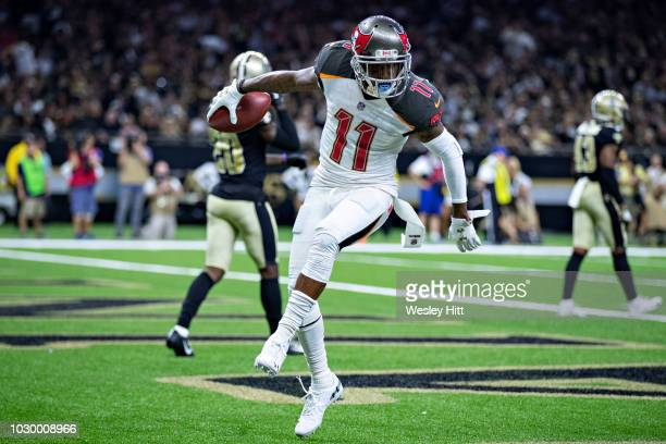 DeSean Jackson of the Tampa Bay Buccaneers celebrates in the end zone with a dance after catching a touchdown pass against the New Orleans Saints at...