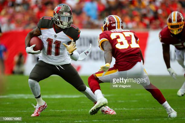 DeSean Jackson of the Tampa Bay Buccaneers runs with the ball against Greg Stroman of the Washington Redskins in Tampa Florida on Sunday Nov11 2018