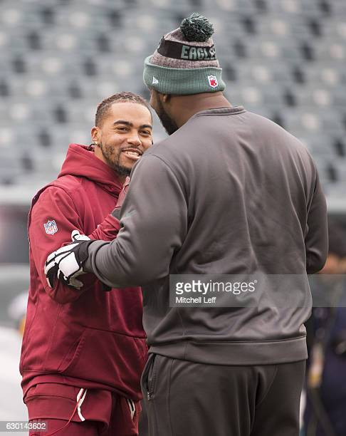 DeSean Jackson of the Washington Redskins talks to Fletcher Cox of the Philadelphia Eagles prior to the game at Lincoln Financial Field on December...