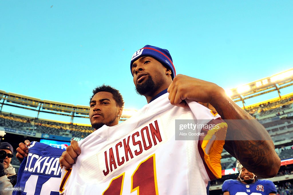 DeSean Jackson #11 of the Washington Redskins trades jerseys with Odell Beckham Jr. #13 of the New York Giants after their game at MetLife Stadium on December 14, 2014 in East Rutherford, New Jersey. The New York Giants defeated the Washington Redskins 24 to 13.
