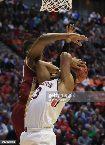 Desean Murray of the Auburn Tigers attempts to shoot against Jaylen McManus of the Charleston Cougars in the second half in the first round of the...