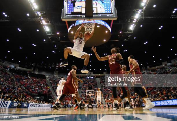 Desean Murray of the Auburn Tigers dunks against Marquise Pointer and Jaylen McManus of the Charleston Cougars in the first half in the first round...