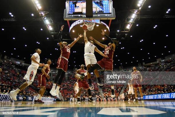 Desean Murray of the Auburn Tigers shoots against Marquise Pointer and Jaylen McManus of the Charleston Cougars in the first half in the first round...